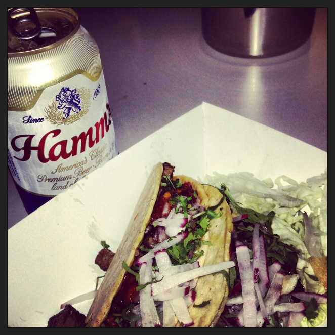 A six dollar meal at Garaje  during happy hour: canned Hamm's and skirt steak tacos